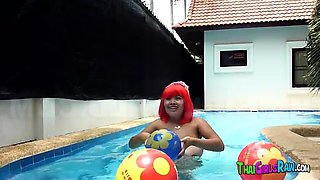 Chubby Thai babe in the swimming pool